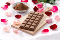 Milk chocolate with rose petals Royalty Free Stock Images