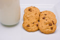 Milk and cookies a glass of half a dozen on a plate Stock Photography