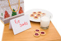 Milk and cookies left out for santa on white background Stock Photos