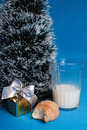 Milk,croissants,souvenir near tree of Christmas Royalty Free Stock Photo