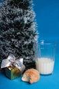 Milk,croissants,souvenir near tree of Christmas Royalty Free Stock Photo