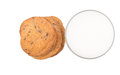 Milk and home made cookies iii a glass of over white background Stock Photo