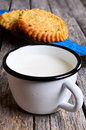 Milk in the metal cup on a wooden surface Royalty Free Stock Images