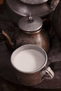 Milk mug and old teapot and kettle in a kyrgyz yurt kitchen Royalty Free Stock Photo