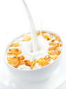 Milk pouring into a bowl of corn flakes Royalty Free Stock Photo