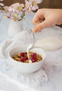 Milk pouring onto muesli raspberry Stock Photo
