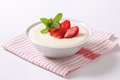 Milk pudding with strawberries bowl of semolina fresh Stock Photo