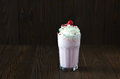 Milk shake banana and raspberries with cream Royalty Free Stock Photo