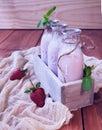 Milk shake da morango em uma tabela de madeira rústica Imagem de Stock Royalty Free