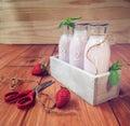 Milk shake da morango em uma tabela de madeira rústica Fotos de Stock Royalty Free