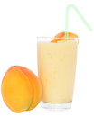 Milk shake from peach yogurt on a white background Royalty Free Stock Images