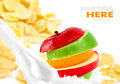 Milk splash with apple on corn flakes Stock Photography