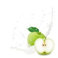 Milk splash apple photo of green with leaf and isolated on white Stock Images