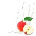 Milk splash apple photo of red with leaf and isolated on white Royalty Free Stock Photography