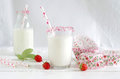 Milk with sugar sprinkles, strawberries and cupcake wrapper Royalty Free Stock Photo