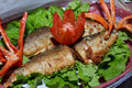 Milkfish fry in the present white rice and fresh vegetables Stock Photos