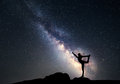 Milky Way. Night sky and silhouette of a sporty woman Royalty Free Stock Photo