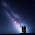 Milky Way with silhouette of people on the mountain Royalty Free Stock Photo