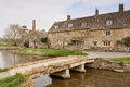 The mill lower slaughter cotswolds a view of with bridge and stream in foreground this quaint village is known for it s unspoilt Royalty Free Stock Photography