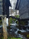 Mill on water river with winter landscape Stock Photos