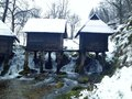 Mill on water river with winter landscape Royalty Free Stock Image