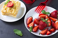 Mille feuille puff pastry known as the napoleon vanilla slice or custard garnished with strawberries Royalty Free Stock Photography