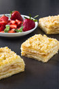 Mille feuille puff pastry known as the napoleon vanilla slice or custard garnished with strawberries Stock Images