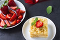 Mille feuille puff pastry known as the napoleon vanilla slice or custard garnished with strawberries Stock Image
