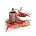 Milled and desiccated red chili pepper with grinder isolated on white background Royalty Free Stock Photography