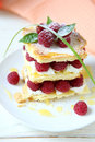 Millefeuille with fresh raspberries and honey food close up Stock Images