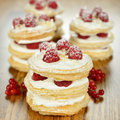 Millefeuille with raspberry on a brown table Royalty Free Stock Photography