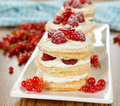 Millefeuille with raspberry on a brown table Stock Photos