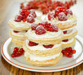 Millefeuille with raspberry on a brown table Stock Photo