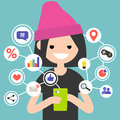 Millennial consuming online content on mobile device Royalty Free Stock Photo