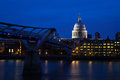 Millennium bridge st pauls cathedral london the modern century footbridge crosses over the river thames to an english baroque Royalty Free Stock Image