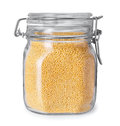 Millet in a glass jar isolate Royalty Free Stock Photo