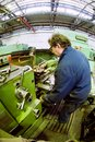 Milling machine operator works at machine tyumen russia november jsc tyumenskie motorostroiteli plant on production and repair of Royalty Free Stock Image