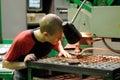 Milling machine operator works at machine tyumen russia november jsc tyumenskie motorostroiteli plant on production and repair of Royalty Free Stock Photography