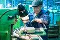 The milling machine operator works at the machine tyumen russia september jsc tyumenskie motorostroiteli plant on production and Stock Photography