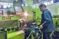 Milling machine operator works at machine tyumen russia september jsc tyumenskie motorostroiteli plant on production and repair of Royalty Free Stock Photography