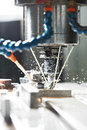 Milling the metal blank with coolant Royalty Free Stock Image