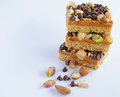 Millionaires shortbread topped with assorted nuts and chocolate chips Royalty Free Stock Photo