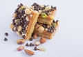 Millionaires shortbread topped with assorted nuts and chocolate chips Royalty Free Stock Images