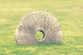 Millstone old with vintage effect Royalty Free Stock Photos