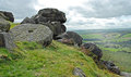 Millstone and Rock Stack on a Derbyshire Hill Side Royalty Free Stock Image