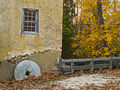 Millstone and Wall Royalty Free Stock Photography