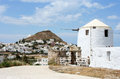 Milos island old windmill in with main town in background Royalty Free Stock Photography