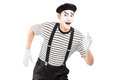 Mime artist running and looking at camera isolated on white background Royalty Free Stock Photography