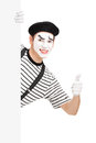 Mime dancer giving a thumb up behind a white panel isolated on background Stock Images