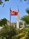 Minaret of Kelerlik Mahallesi Cami mosque with the flag of Turke Royalty Free Stock Photo